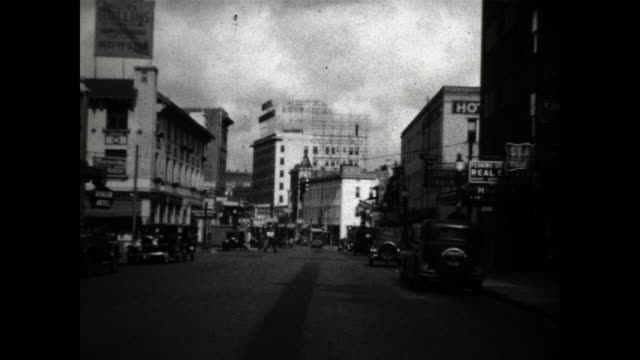 still shot of a street in florida in the 30's; buildings and cars parked by the sidewalk - the cars stock videos & royalty-free footage