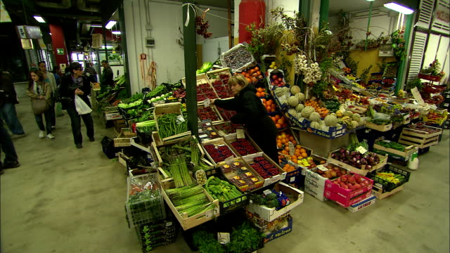 still shot of a woman tending a produce stand - florence italy stock videos and b-roll footage