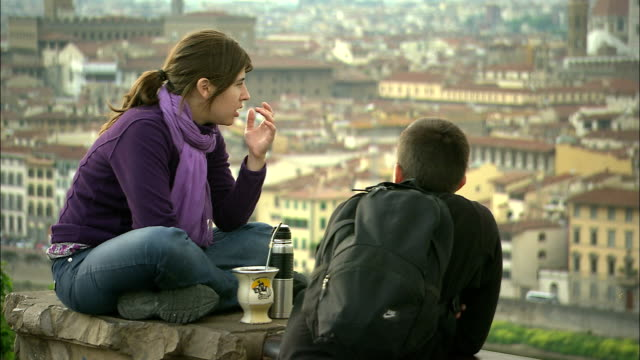 still shot of a young couple enjoying a view of the city. - romantic activity stock videos & royalty-free footage