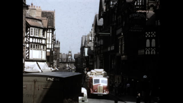 """still shot of busy street in chester, uk; people walking on the sidewalk and cars passing on the street; sign on truck """"hunter's furniture manchester"""" - the cars stock videos & royalty-free footage"""