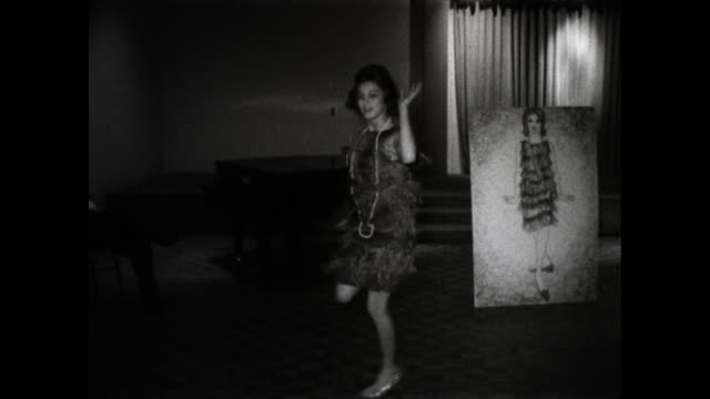 still shot of girl in dress dancing; board with drawing of her in the same dress in the background - young women stock videos & royalty-free footage