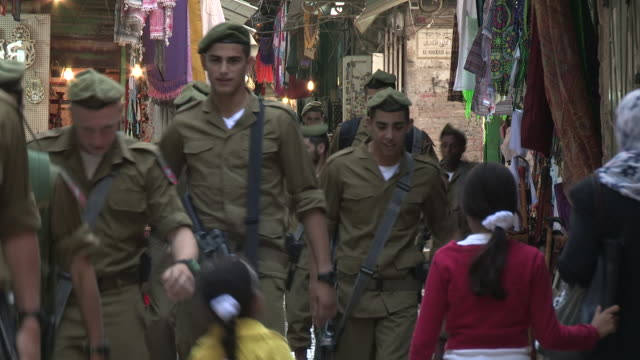 still shot of idf soldiers walking through a small street. - israeli military stock videos & royalty-free footage