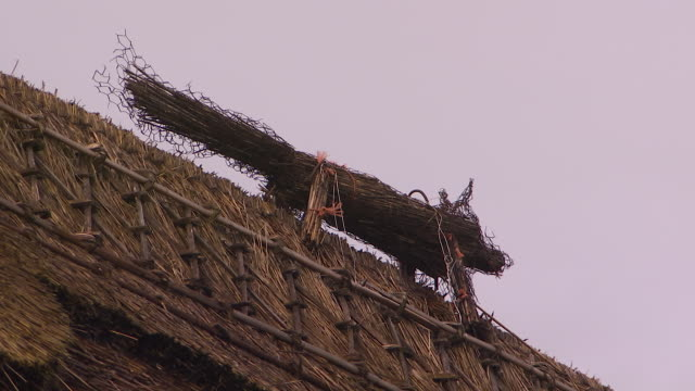 still shot of old rolled up fencing on a house - thatched roof stock videos and b-roll footage