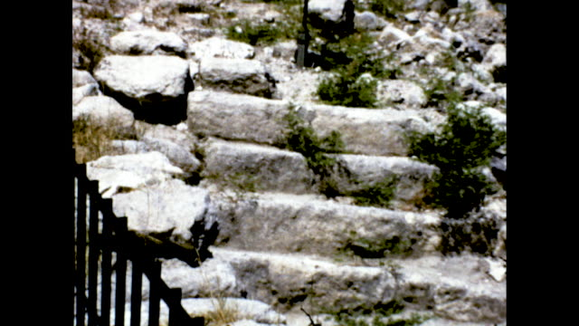 still shot of orange sign megiddo megiddo is one of the most ancient cities in the land panning shot of woman smiling at the camera green hills and... - uphill stock videos & royalty-free footage