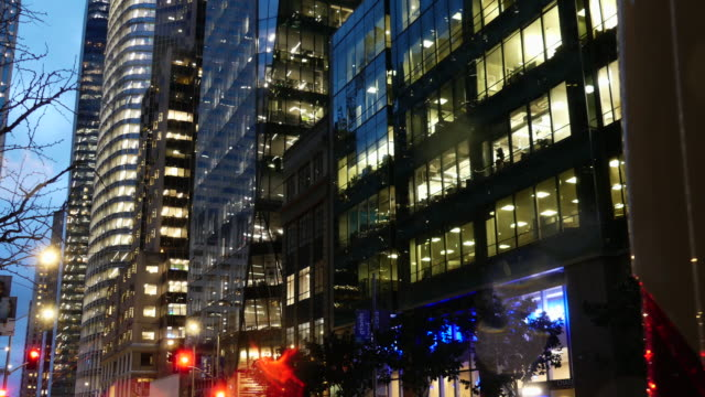 still shot of san francisco buildings at dusk; lights on behind the windows - office block exterior stock videos & royalty-free footage