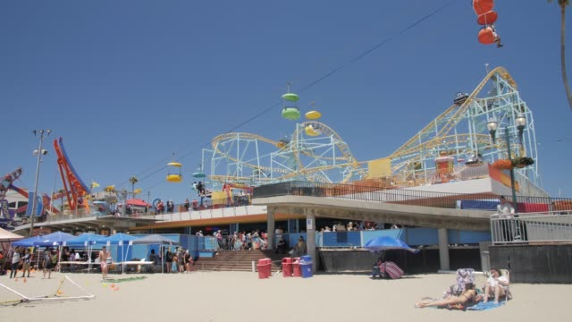 still shot of santa cruz broadwalk funfair ride and beach, santa cruz, california, united states of america, north america - fairground stock videos and b-roll footage