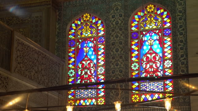 still shot of stained glass and walls in mosque - イラン点の映像素材/bロール