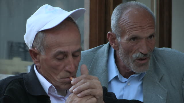 still shot of two older men one smoking a cigarette no - balding stock videos & royalty-free footage