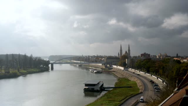 4k still shot of votive church and cathedral of our lady of hungary, river tisa and szeged bridge - eastern european culture stock videos & royalty-free footage