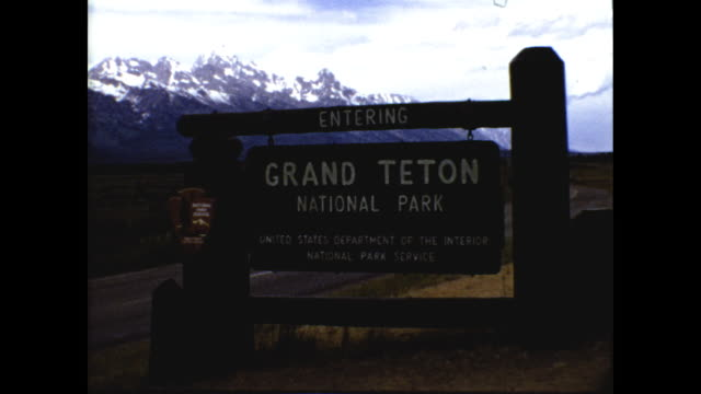 "still shot of wooden sign ""entering grand teton national park"" ""united states department of the interior national park service""; panning shot of... - grand teton stock videos & royalty-free footage"
