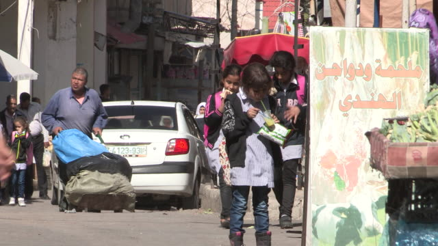 still shot of younger schoolgirls with traffic in bg - palestine girl stock videos and b-roll footage