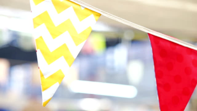 cu still shot : yellow zigzag and red flags decorated for a festival with blurred background. - zigzag stock videos & royalty-free footage