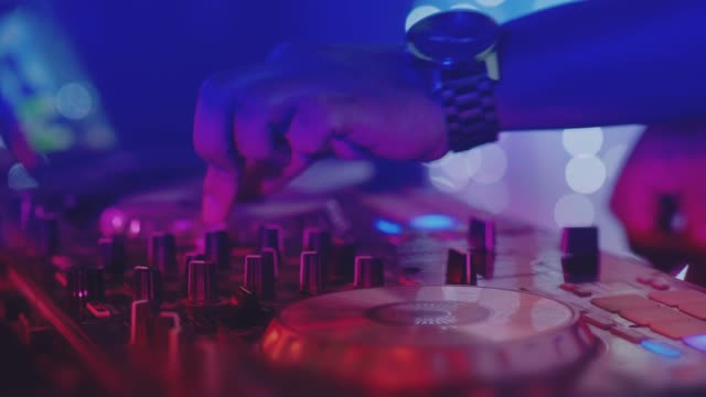 a still unused dj mixer under glowing lights. - mixing stock videos & royalty-free footage