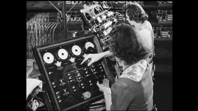 still view of disassembled machinery with inner working displayed; panel with dials and spinning needles; woman tightening wires on cylindrical... - 1940 1949 stock videos & royalty-free footage