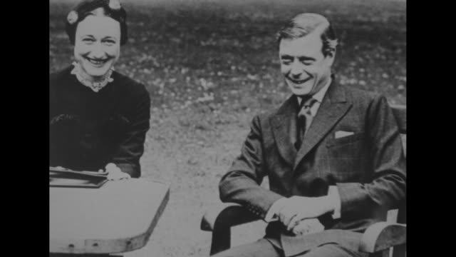 Still Wallis Simpson with Edward Duke of Windsor seated outdoors and smiling / Note exact day not known