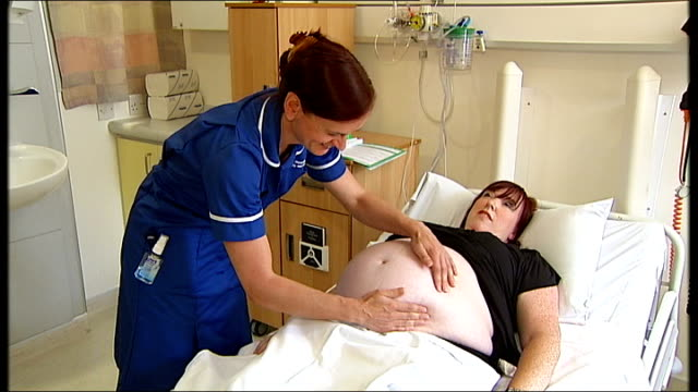 Professor alleges NHS restructuring flaws are undermining progress Midwife examining and pregnant woman's stomach during examination at West Midlands...