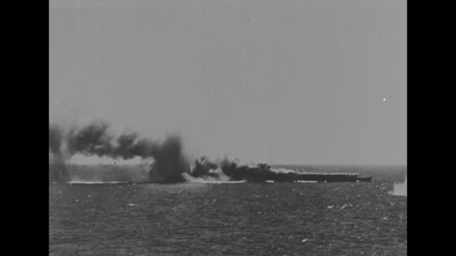 Japanese ship Shoho burns sinks after having been sunk by US military carrier planes from the USS Lexington and USS Yorktown during the WWII Battle...