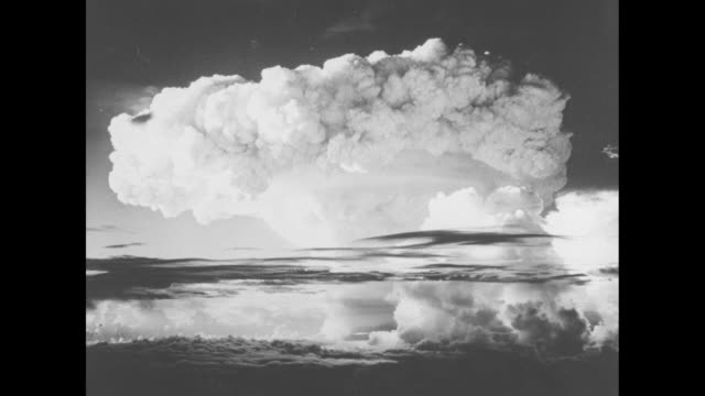 [11/1/1952] stills of hydrogen bomb explosion // [4/1/1954] new york journalamerican headline aec chief says hbomb can wipe out any city new york... - hydrogen bomb stock videos and b-roll footage