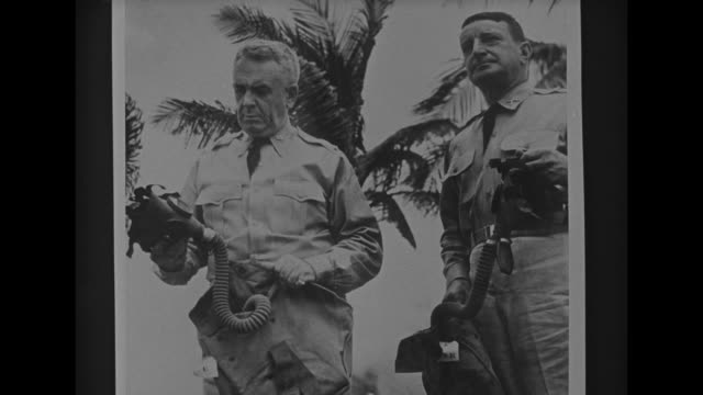 general russell p. hartle stands with his horse during world war i / vs hartle and another officer hold gas masks during world war ii / standing in... - shirt and tie stock videos & royalty-free footage