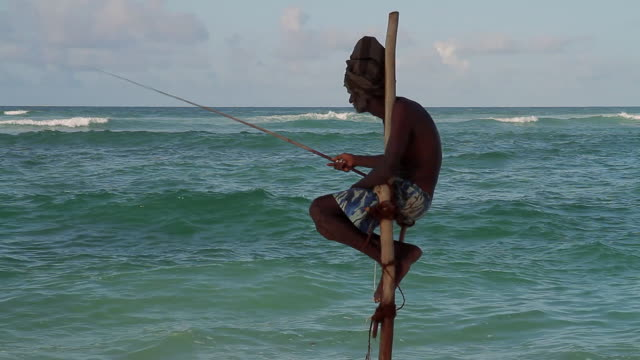ms stilt fisherman casting for sardines / hikkaduwa, southern province, sri lanka - sri lankan culture stock videos & royalty-free footage