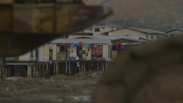 stilt houses on a muddy ground, hanuabada village - stilt house stock videos & royalty-free footage