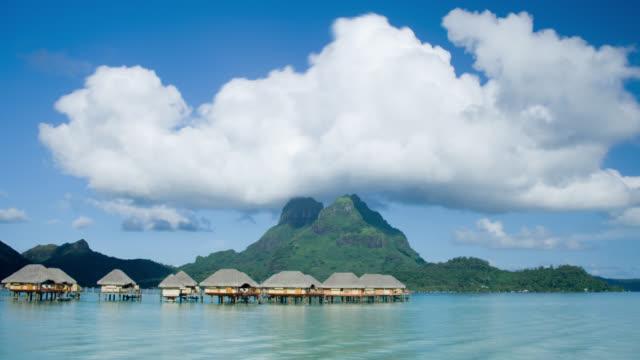 fm ws stilt huts on water at pearl beach resort near mt. otemanu/ bora bora, tahiti  - medium group of objects stock videos & royalty-free footage