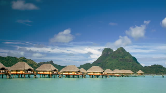 tl ws stilt huts on water at pearl beach resort near mt. otemanu/ bora bora, tahiti  - medium group of objects stock videos & royalty-free footage