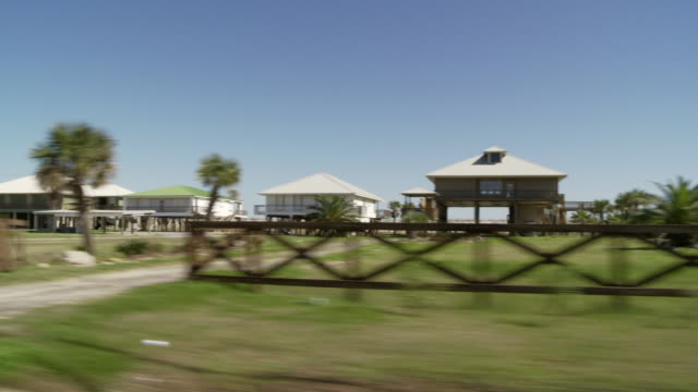 stilted houses line a neighborhood street in houma, louisiana. - stilts stock videos and b-roll footage