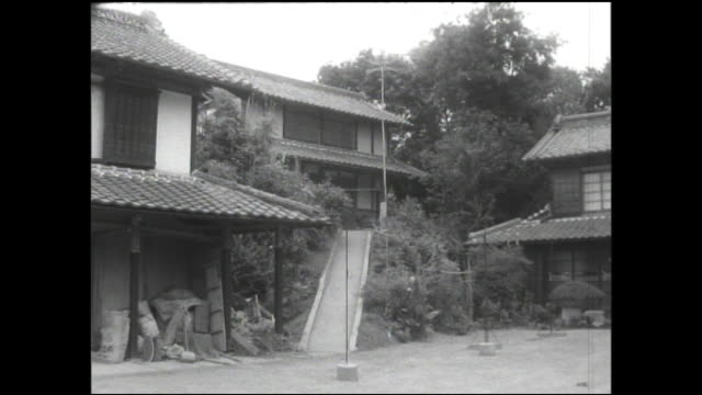stockvideo's en b-roll-footage met stilts support an old house on a hill near japan's tone river. - showaperiode