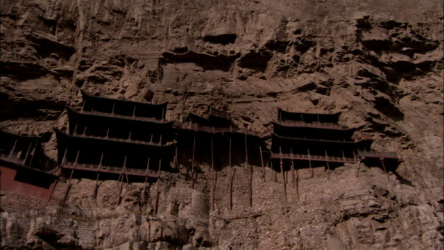 stilts support the hanging temple. available in hd. - stilts stock videos and b-roll footage