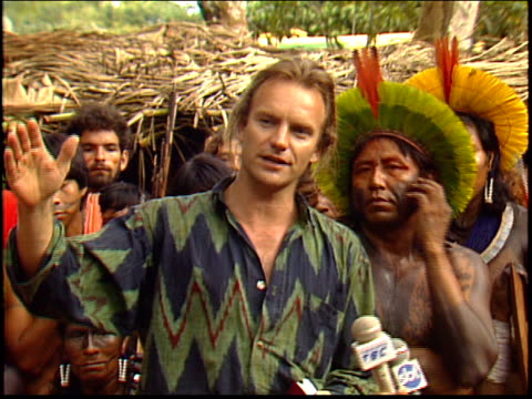 Sting gives a press conference speech in the Amazon in which he talks about saving the rainforest with the help of the Kayapo Indians