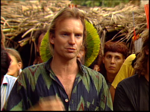 vídeos y material grabado en eventos de stock de sting talks about the importance of protecting the kayapo indians as a way of protecting the rainforest in the amazon during a press conference - yanomami