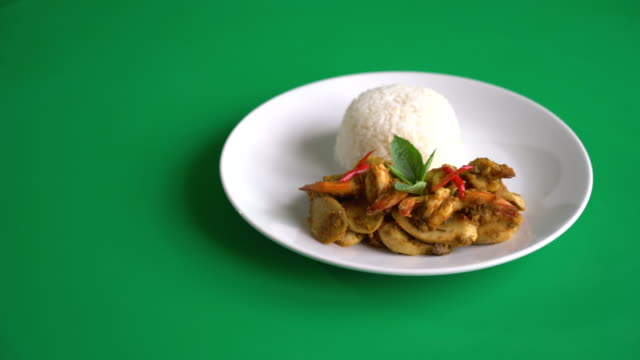 Stir fried shrimp and green curry with rice on green screen