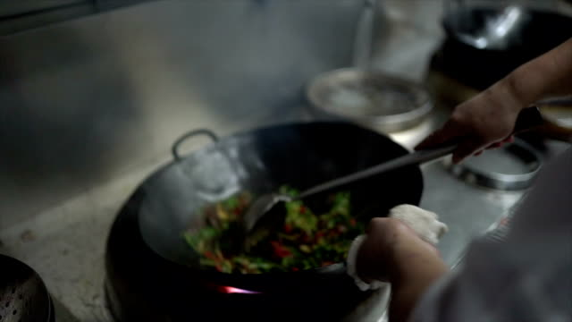stir frying beef with chili pepper in slow motion