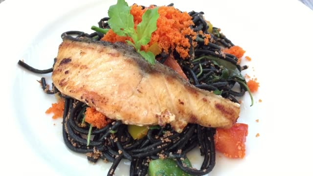 stir-fried black spaghetti pasta with grilled salmon fish - grilled salmon stock videos & royalty-free footage
