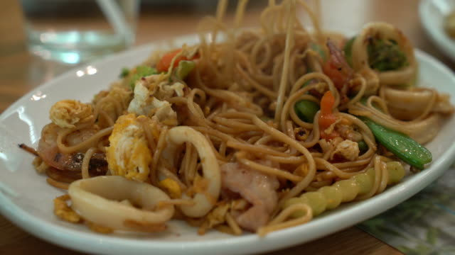 stir-fried noodles with seafood and vegetable - lunch stock videos & royalty-free footage