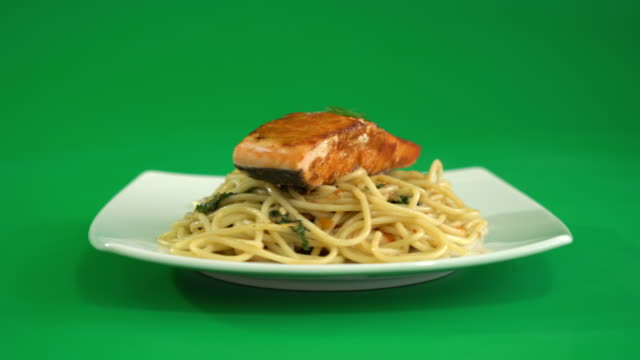 stir-fried spicy spaghetti with grilled salmon