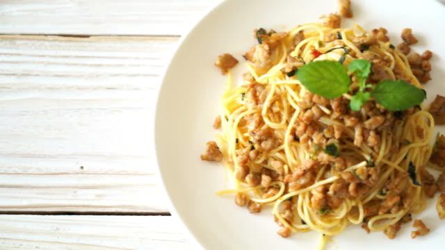 stir-fried spicy spaghetti with minced pork and basil