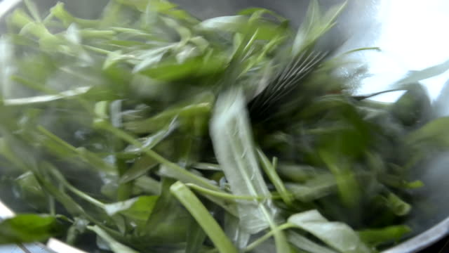 stir-fried water morning glory - morning glory stock videos & royalty-free footage