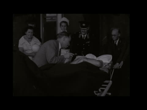 stirling moss returns to england after belgian practice crash england london st thomas's hospital ext ambulance along to private patients wing... - towel stock videos & royalty-free footage