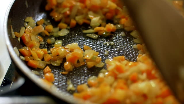 stirred vegetables in a pan, slo mo - stove stock videos & royalty-free footage