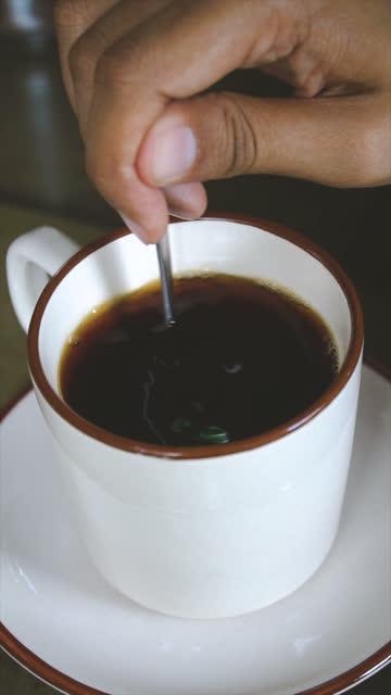 slomo stirring a cup of black coffee - stirring stock videos & royalty-free footage
