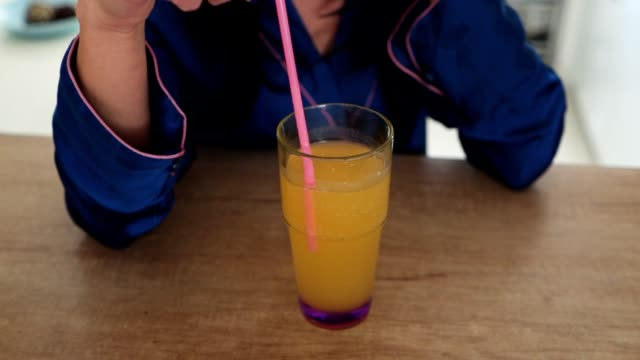 stirring a glass of orange juice - juice extractor stock videos & royalty-free footage