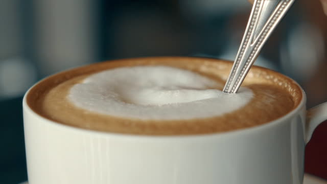 stirring cappuccino slow motion - cup stock videos & royalty-free footage