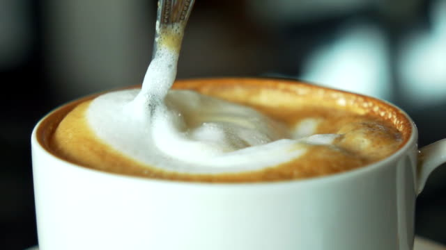 Stirring cappuccino slow motion