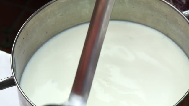 stirring milk in large metal pot - vitamin d stock videos & royalty-free footage