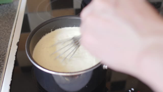 stirring panna cotta mixture - stirring stock videos & royalty-free footage