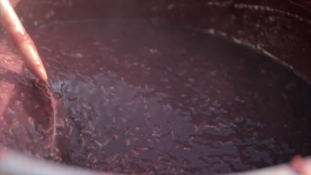 stirring 'patjuk' (korean red bean porridge) with a ladle - bean stock videos & royalty-free footage