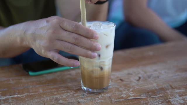 stirring tasty ice latte. - ice cube stock videos & royalty-free footage