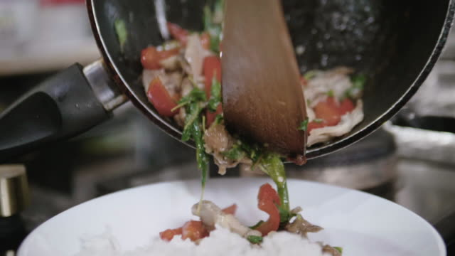 stirring the food with mixing spoon - iron appliance stock videos and b-roll footage